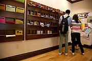 Zeyingsang Yao, Zhujia Wang, and Songqi Huang read pamphlets while waiting for an advisor in the Walter International Education Center