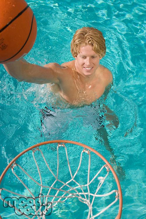 Young Man Playing Water Basketball