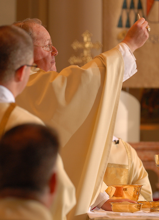 Archbishop Timothy Dolan raises the consecrated host during an ordination Mass for permanent deacons June 9, 2007, at the Cathedra of St. John the Evangelist in Milwaukee. (Sam Lucero photo)