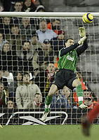 Photo: Aidan Ellis.<br /> Liverpool v Arsenal. The Barclays Premiership. 14/02/2006.<br /> Liverpool's Jerzy dudek saves from Thierry Henry