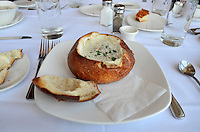 Menu favourite, New England clam showder served in a hollowed-our bread bowl, Fisherman's Wharf, San Francisco, California, USA, 201304131365<br /> <br /> Copyright Image from Victor Patterson, 54 Dorchester Park, Belfast, UK, BT9 6RJ<br /> <br /> Tel: +44 28 9066 1296<br /> Mob: +44 7802 353836<br /> Voicemail +44 20 8816 7153<br /> Skype: victorpattersonbelfast<br /> Email: victorpatterson@me.com<br /> Email: victorpatterson@ireland.com (back-up)<br /> <br /> IMPORTANT: If you wish to use this image or any other of my images please go to www.victorpatterson.com and click on the Terms & Conditions. Then contact me by email or phone with the reference number(s) of the image(s) concerned.