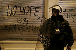 Riot police officer in front of graffiti that reads : No Hope. Leftist groups hold a demonstration to mark the 8th anniversary of the murder of Alexandros Grigoropoulos who was shot dead by police officer Epaminondas Korkoneas in 2008. Athens, Greece, December 6, 2016. Photo by Panayotis Tzamaros/ABACAPRESS.COM