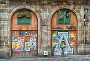 Spain, Barcelona. Street art and abandoned notices line the streets of Barcelona.