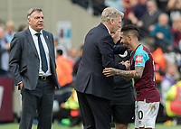 Football - 2017 / 2018 Premier League - West Ham United vs. Everton<br /> <br /> David Moyes, Manager of West Ham United, congratulates Manuel Lanzini (West Ham United) after he is substituted as Sam Allardyce, Manager of Everton FC, looks on at the London Stadium<br /> <br /> COLORSPORT/DANIEL BEARHAM