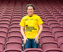 Edinburgh, Scotland, United Kingdom, 2 August 2019. Edinburgh Festival Fringe: Photocall prior to this evening's Edinburgh International Festival Aberdeen Standard Investments Opening Event: LA Phil at Tynecastle with conductor Gustavo Dudamel ahead of the Aberdeen Standard Investments Opening Event: LA Phil at Tynecastle stadium, home to Hearts football club.<br /> Credit: Sally Anderson/Alamy Live News