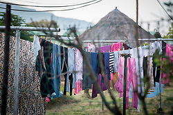 "2 March 2017, Morija, Maseru district, Lesotho: Laundry hanging to dry, at Scott Hospital. Scott Hospital is run by the Lesotho Evangelical Church in Southern Africa and is a founding member of the Christian Health Association of Lesotho. It is located in the village of Morija, and operates and supervises clinics in the Maseru District of Lesotho. Scott started out as a dispensary in 1864, and today offers comprehensive healthcare Mondays-Fridays, as well as pharmaceutical services around the clock. Lesotho suffers from high numbers in Tuberculosis in disesase and mortality, and so the hospital screens all patients for TB. The hospital observes among many patients what they describe as ""low health-seeking behaviour"", services are increasing and demand rising, but space and human resources are a challenge, as is funding. I key concern is one of infrastructure, where the original design of the hospital matches poorly with current needs, as departments and buildings are scattered, posing a challenge for security. Another challenge is to adapt donation structures, so as to be able to receive payments electronically. The hospital has one ambulance, which they describe as not enough, but what they have. Another challenge is that lack of funds affects maintenance of buildings and infrastructure, as the immediate care of patients take priority. PLEASE NOTE: This photo is not to be used in social media."