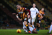 No penalty as Bradford City midfielder, on loan from Sheffield United, Marc McNulty (18) goes over in the penalty area under the challenge of Northampton Town defender Gabriel Zakuani (6)  during the EFL Sky Bet League 1 match between Bradford City and Northampton Town at the Coral Windows Stadium, Bradford, England on 22 November 2016. Photo by Simon Davies.