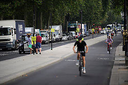 © London News Pictures. 25/08/2016. A tailbacks of traffic along embankment in Westminster caused by new cycle lanes installed which have reduced the traffic to one lane.. Cyclists repeatedly ignore new cycle lanes installed around westminster in central London. Between the hours of 8am and 9am on Wednesday 24/08/2016, 266 (two hundred and sixty six) cyclists passed through the red light at one of the newly installed  bike lanes and only 15 (fifteen) cyclists stopped.  The light system is designed to allow either vehicles or cyclists to pass at one time in order to make the junction safer for cyclists..... **VIDEO AVAILABLE** Photo credit: London News Pictures.