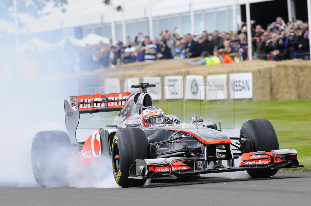 © Licensed to London News Pictures. 30/06/2012 .Jenson Button in his F1 car.The Goodwood Festival of Speed is the largest motoring garden party in the world - a unique summer weekend, The largest car culture event in the world. Held in the grounds of Goodwood House,Chichester..Photo credit : Grant Falvey/LNP