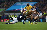 Australia's Captain Stephen Moore getting tackled by Scotland's Dave Denton on his 100th cap during the Rugby World Cup Quarter Final match between Australia and Scotland at Twickenham, Richmond, United Kingdom on 18 October 2015. Photo by Matthew Redman.