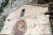 The hermitage cave and church at lake Megali Prespa Macedonia, Greece Virgin of Tenderness icon