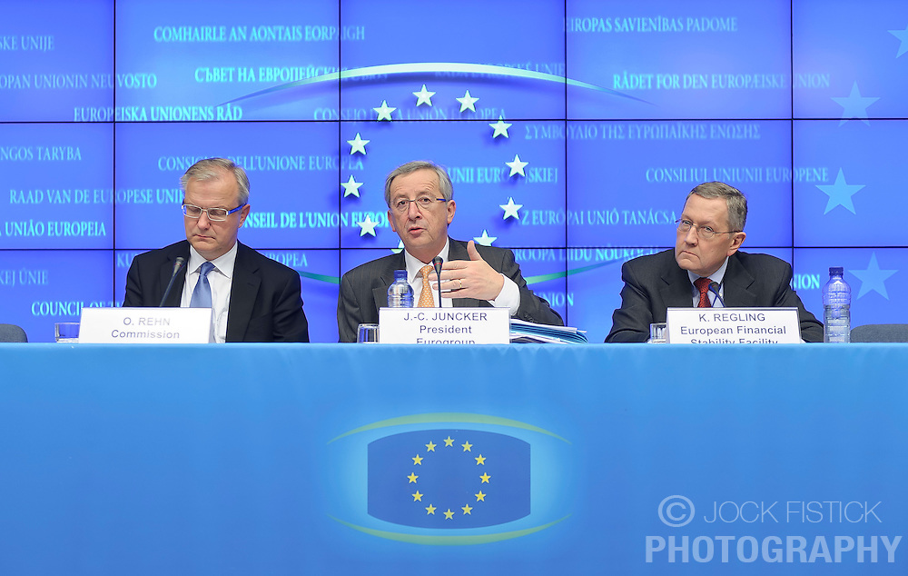 Jean-Claude Juncker, Luxembourg's prime minister, and president of the Eurogroup, center, speaks during a joint press conference with Olli Rehn, The EU's economic and monetary affairs commissioner, left, and Klaus Regling, chief executive officer of the European Financial Stability Fund (EFSF), following the Eurogroup meeting in Brussels, Monday Dec. 6, 2010.  (Photo © Jock Fistick).