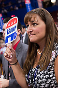 A New Jersey delegate holds up a Trump sign during the second day of the Republican National Convention July 19, 2016 in Cleveland, Ohio. The delegates formally nominated Donald J. Trump for president after a state by state roll call.