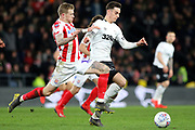 Derby County forward Tom Lawrence on the ball as Stoke City midfielder James McClean challenges during the EFL Sky Bet Championship match between Derby County and Stoke City at the Pride Park, Derby, England on 12 March 2019.