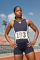 Female track athlete standing on track