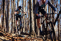 Gordon Wadsworth and Andrew Dunlap mountain biking on trails on Mill Mountain in the Blue Ridge Mountains around Roanoke, Virginia. Mountain biking in the Blue Ridge Mountains. Mountain biking man, woman, kids in virgina, north carolina, montana, and california.