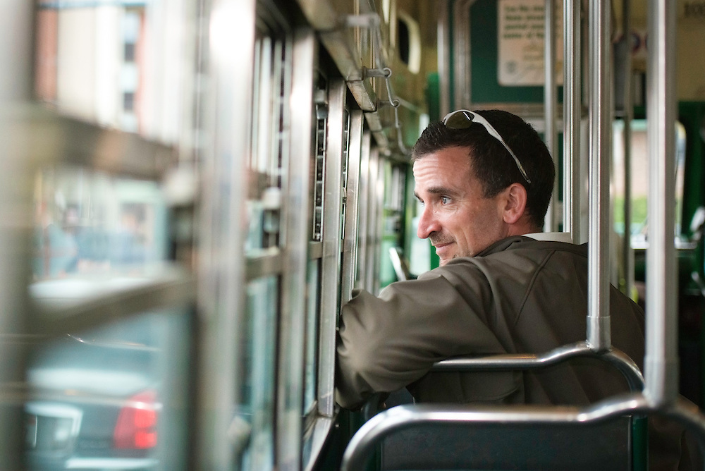 A passenger looks out the window of a historic streetcar | March 19, 2013
