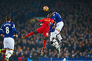 Liverpool midfielder Sadio Mane (19) challenges Everton  defender Ramiro Funes Mori (25)  during the Premier League match between Everton and Liverpool at Goodison Park, Liverpool, England on 19 December 2016. Photo by Simon Davies.