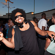 partying on the roof of the Prince of Wales in Brixton with Jazzy B from Soul II Soul.