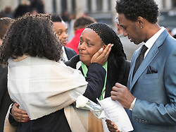 © Licensed to London News Pictures. 14/12/2017. London, UK. Nyalissa Mendy (C) is consoled by a friend after she attended St Paul's Cathedral for the Grenfell Tower National Memorial Service mark the six month anniversary of the Grenfell Tower fire. Ms Mendy is a releative of Grenfell fire victim Mary Mendy. The service is attended by survivors and relatives of those who lost their lives in the fire, as well as members of the emergency services and members of the Royal family. 71 people were killed when a huge fire ripped though 24-storey Grenfell Tower block in west London in June 2017. Photo credit: Peter Macdiarmid/LNP