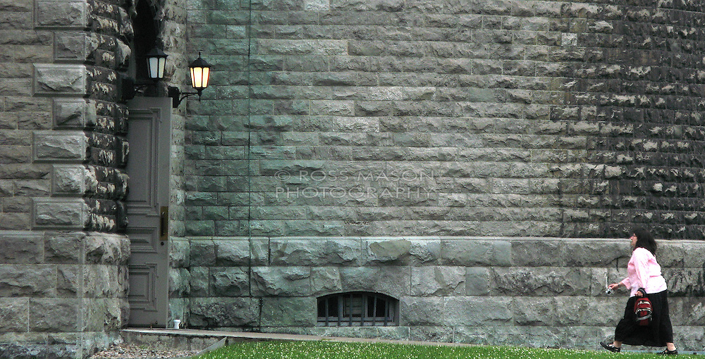 Woman walks toward St. Mary's Cathedral in Montreal, PQ