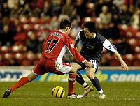 Photo: Leigh Quinnell.<br /> Middlesbrough v Manchester City. The Barclays Premiership. 31/12/2005. Man Citys Jihai Sun looks for a way past Middlesbroughs Doriva.