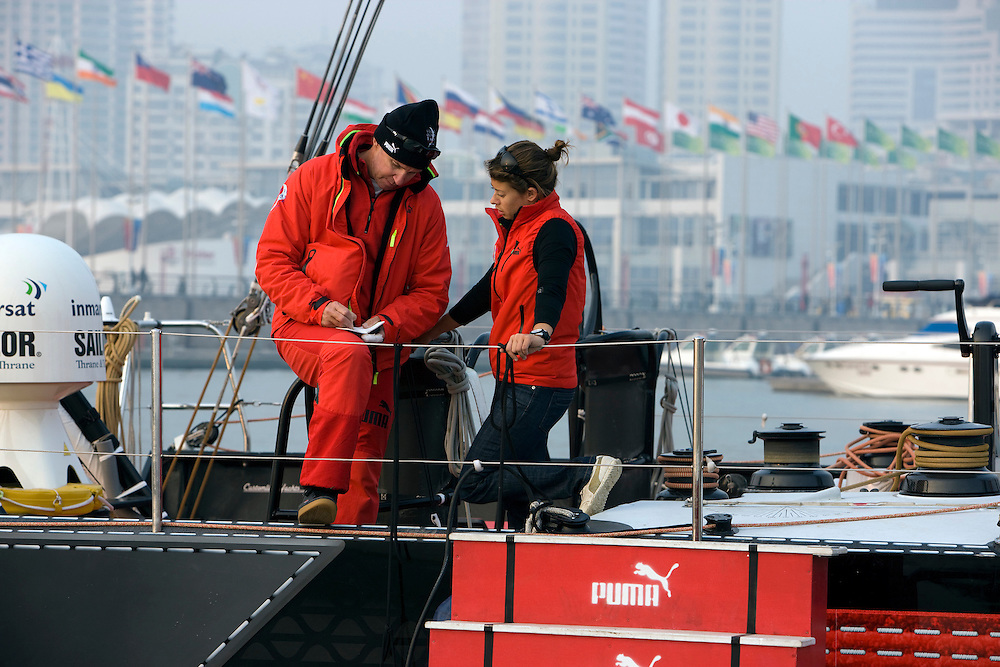 05FEB09. Skipper Ken Read talks to PUMA Ocean Racing's Logisticfs Manager Tara Thomas after Il Mostro goes for her first sail in Qingdao after being put back in the water in Qingdao