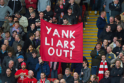 "LIVERPOOL, ENGLAND - Sunday, March 28, 2010: Liverpool's supporters on the Spion Kop display a banner reading ""YANK LIAR$ OUT!"" in protest at the club's American owners before the Premiership match against Sunderland at Anfield. (Photo by: David Rawcliffe/Propaganda)"