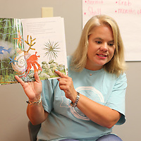 "Robin Maynard reads the book ""A house for a hermit crab"" during Monday's Summer S.A.L.T. program at the Orchard in Tupelo."