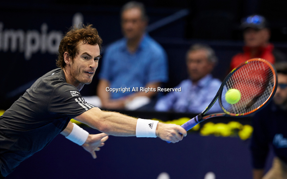 24.10.2014.  Valencia, Spain. Andy Murray of Great Britain versus Kevin Anderson of South Africa. Valencia Open 500 Tennis. Andy Murray of Great Britain stretches to play a backhand