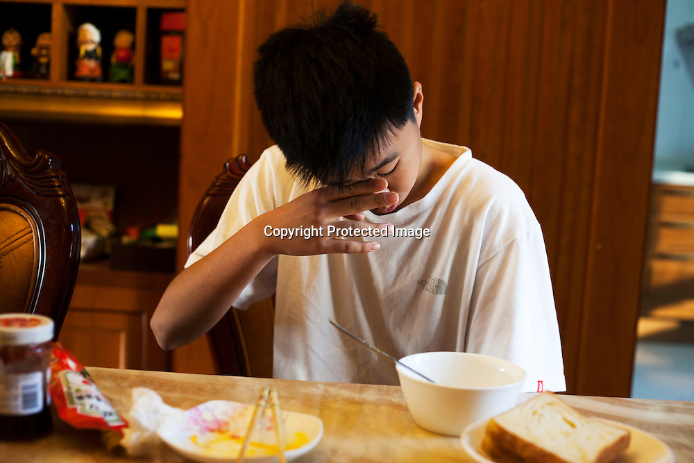 BEIJING, OCT.18, 2014 : Song Yonglin, 14, is tired although he says he doesn't mibnd getting up so early on a free weekend. He spends every weekend taking extra school lessons in order to improve his scores which cost his parents about 4-5000 Yuan/month. He would like to switch to the International school in Beijing  and study economics later on in the US.
