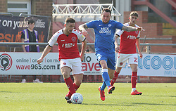 Lee Tomlin of Peterborough United in action with Lewis Coyle of Fleetwood Town - Mandatory by-line: Joe Dent/JMP - 19/04/2019 - FOOTBALL - Highbury Stadium - Fleetwood, England - Fleetwood Town v Peterborough United - Sky Bet League One