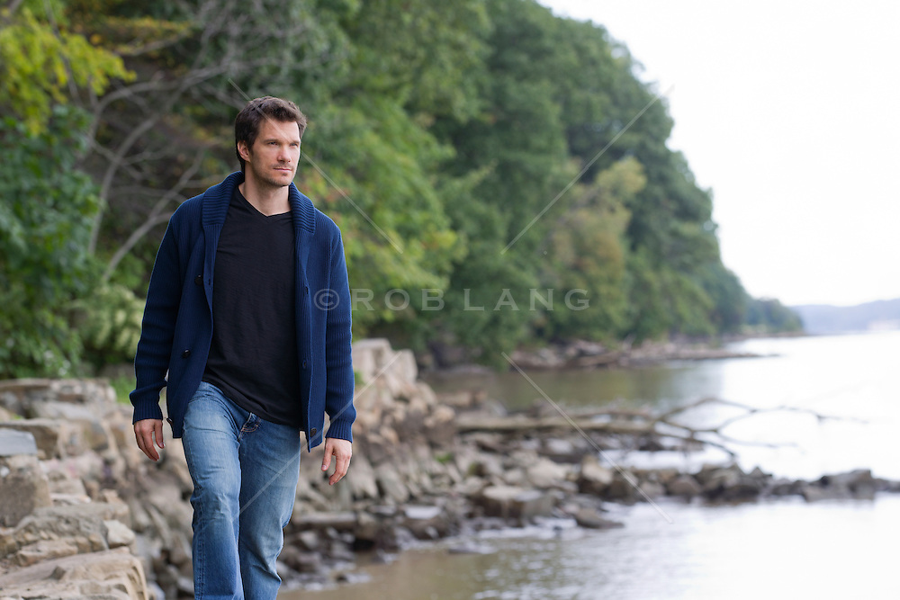 man standing on the shore of The Hudson River in New Jersey