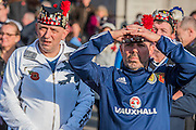 Scots fans, in town for tonights international against England, join people of all backgrounds pay their respects - Silence in the Square oraganised by the British Legion in Trafalgar Square  - 11 November 2016, London.