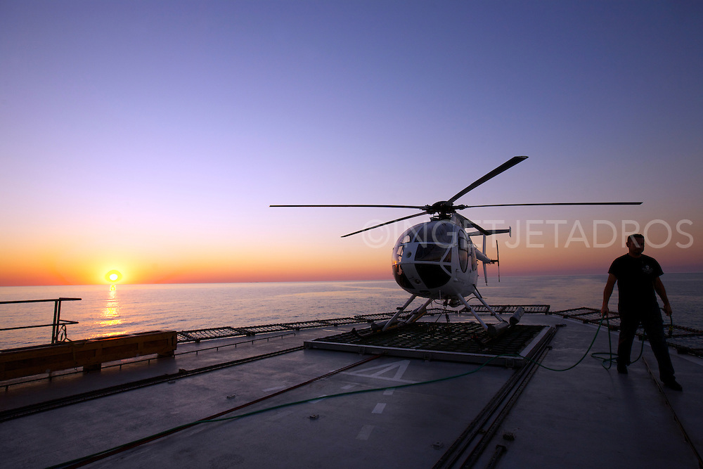 The helicopter platform is restricted area on the 'Steve Irwin'. Tim Pierce is Sea Shepherd's Aviation Director and doing the last check-up before it gets dark. Tim is a helicopter technician from the USA.