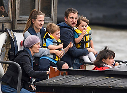 © Licensed to London News Pictures. 22/06/2016. London, UK.  A barge carrying BRENDAN COX, husband of murdered MP Jo Cox, arrives in Westminster with his children CUILLIN and LEJLA for a memorial service to mark the life of murdered Labour MP for Batley and Spen, who would have turned 42 today.   Photo credit: Ben Cawthra/LNP
