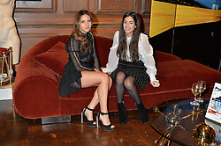 ***UK_MAGAZINES_OUT***<br /> LONDON, ENGLAND 30 NOVEMBER 2016: <br /> Left to right, Tara Sahni, Sara Tamimi at the launch of In The Spirit of Gstaad at Maison Assouline, Piccadilly, London hosted by Mandolyna Theodoracopulos and Homera Sahni England. 30 November 2016.