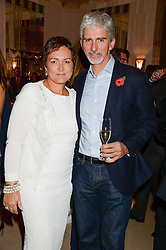 """DAMON & GEORGIE HILL at an """"Evening With Damon Hill'  a dinner and talk in aid of the Downs Syndrome Association held at Claridge's, Brook Street, London on 7th November 2013."""