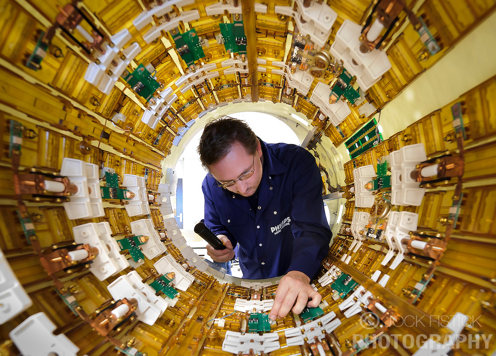 Gyula Ando, a Philips Healthcare engineer, works on the body coil of an MR scanner, at the Philips Healthcare production facility, in Best, the Netherlands, on Tuesday, Oct. 12, 2010. (Photo © Jock Fistick)