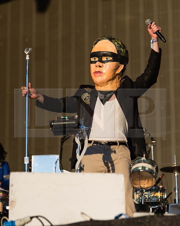 © Licensed to London News Pictures. 03/07/2014. London, UK.   A performer dressed in a costume onstage with Arcade Fire as they perform live at Hyde Park  as part of the Barclaycard British Summer Time series of music events held at Hyde Park this summer.   Photo credit : Richard Isaac/LNP