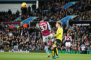 Aston Villa midfielder Albert Adomah (37) clatters into Burton Albion midfielder Matt Palmer (16) during the EFL Sky Bet Championship match between Aston Villa and Burton Albion at Villa Park, Birmingham, England on 26 December 2016. Photo by Richard Holmes.