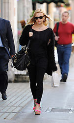 A pregnant Fearne Cotton dressed all black with pink shoes, wearing sunglasses and a star necklace seen arriving at BBC Radio 1 in London. UK. 05/08/2012<br />