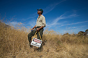 Corey Johnson, SCCP Park Maintenance employee of 30 years, poses for a portrait after cleaning weeds from a parking lot in preparation of Santa Clara County Park's Day on the Bay event at Don Edwards San Francisco Bay National Wildlife Refuge in Alviso, California, on October 8, 2016. Seven SCCP employees and about 30 Santa Clara County inmates put in more than 200 man hours to get the Refuge event-ready. (Stan Olszewski/SOSKIphoto)