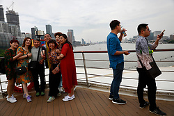 Parents of LGBT (lesbian, gay, bisexual and transgender) take selfies on the deck of a cruise on a cruise trip organised by Parents and Friends of Lesbians and Gays (PFLAG) China organisation in Shanghai, China, 14 June 2017. About 800 members of the Chinese LGBT (lesbian, gay, bisexual and transgender) community and their parents spent four days on a cruise trip organised by Parents and Friends of Lesbians and Gays (PFLAG) China, a grassroots non-government organisation, celebrating the 10th anniversary of the organisation. It aims to promote coexistence among homosexuals and their families.