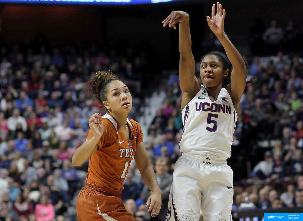UNCASVILLE, CONNECTICUT- DECEMBER 4:  Crystal Dangerfield #5 of the Connecticut Huskies shoots for three watched by Brooke McCarty #11 of the Texas Longhorns during the UConn Huskies Vs Texas Longhorns, NCAA Women's Basketball game in the Jimmy V Classic on December 4th, 2016 at the Mohegan Sun Arena, Uncasville, Connecticut. (Photo by Tim Clayton/Corbis via Getty Images)
