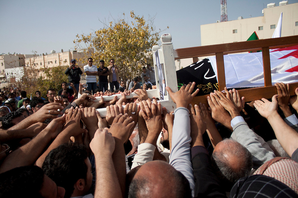 People bury Ali Al Almoumen, the third person to be buried in Sitra on 18/03/11 after he was killed on Wednesday at the Pearl Roundabout.