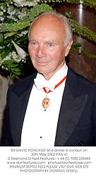 SIR DAVID ROWLAND at a dinner in London on 30th May 2002.PAN 41