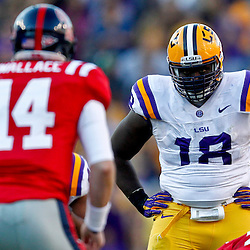 November 17, 2012; Baton Rouge, LA, USA  LSU Tigers defensive tackle Bennie Logan (18) looks over at Ole Miss Rebels quarterback Bo Wallace (14) during a game at Tiger Stadium. LSU defeated Ole Miss 41-35. Mandatory Credit: Derick E. Hingle-US PRESSWIRE