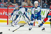 KELOWNA, BC - OCTOBER 16:  Garrett Sambrook #27 prepares to block a shot as Isaac Poulter #1 of the Swift Current Broncos defends the net against the Kelowna Rockets at Prospera Place on October 16, 2019 in Kelowna, Canada. (Photo by Marissa Baecker/Shoot the Breeze)