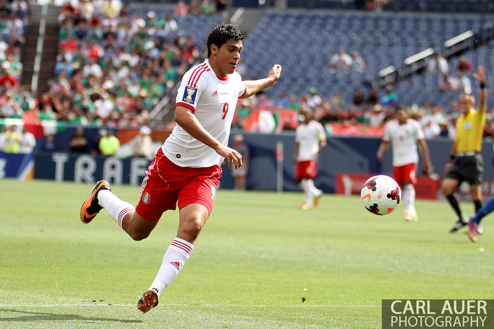 July 14 2013: Mexico Forward Raul Jimenez (9) controls the ball in the first half of the CONCACAF Gold Cup soccer match between Martinique and Mexico at Sports Authority Field in Denver, CO. USA.